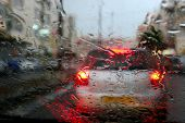 stock photo of speculum  - Rain behind glass of the car - JPG