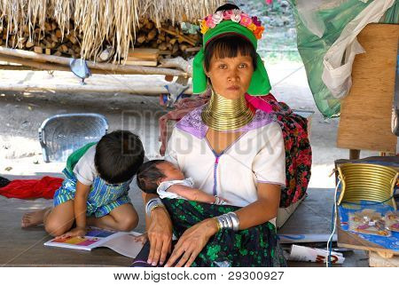 Woman From A Tribe Of Karen With Her Children By Pattaya