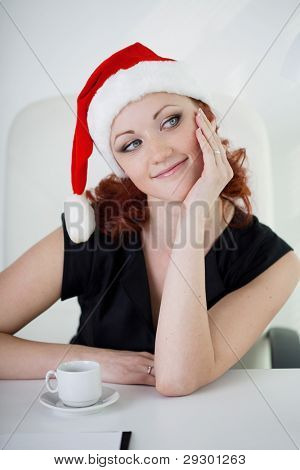 Woman celebrating Christmas in the office