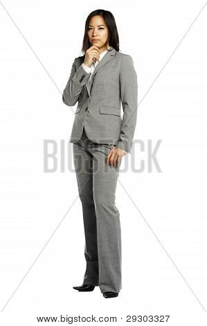 Asian Business Woman Pensive Looking At Camera