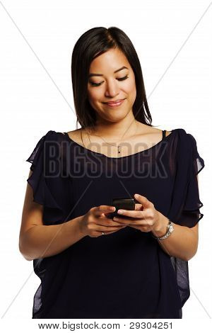 Young Asian Female Smiling While Reading A Text On Her Cell Phone