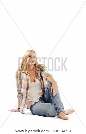 Attractive Young Female Relaxing Against White Background
