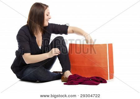 Pretty Young Woman Searching For Her New Dress In Her Shopping Bag