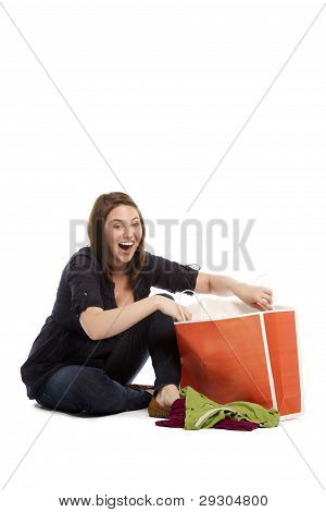 Surprised Woman Searching Her Gifts In Bag