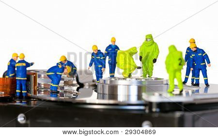 Team Of Technicians Repair Hard Disk