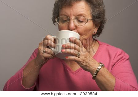 Senior Woman Enjoys Her Coffee