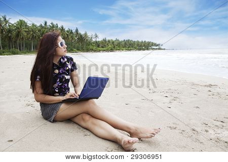 Casual Businesswoman Working On The Beach