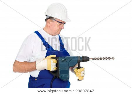 Worker Holding Drill For Concrete