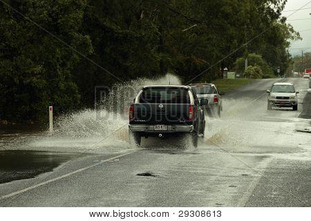 Brisbane, Australia - Jan 25 : One Year On Brisbane Flooding Again, Cars Crossing Flooded Burpengary