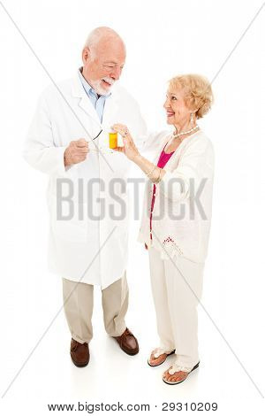 Senior woman questions her trusted pharmacist about medication.  Full body isolated on white.