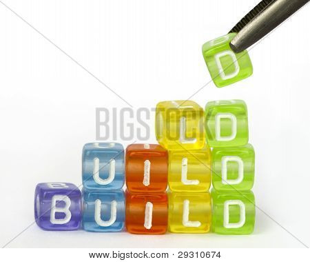 Text Build On Colorful Wooden Cubes
