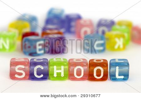 Text construction on colorful wooden cubes over white