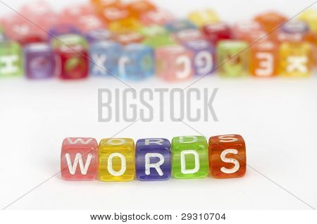 Text Words On Colorful Cubes Over White
