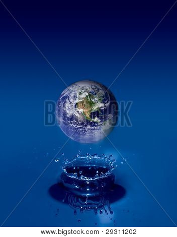 Earth globe floats on water ripples.