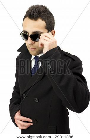 Portrait Of A Serious Standing Man With Sunglasses