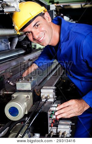 happy modern industrial machine operator at work