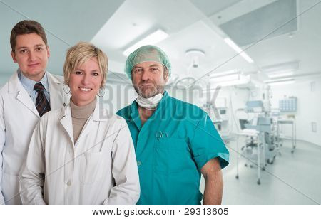 Medical team, with surgeon, anesthetist and nurse in an operating room