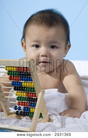 Sweet Baby With A Ball Machine