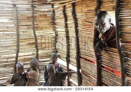 MAASAI VILLAGE SCHOOL, OLDUVAI GORGE, TANZANIA, DECEMBER 23, 2011, PUPILS AND MAN IN WINDOW