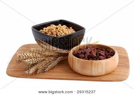 Two Colors Cereals With Decoration On The White Background