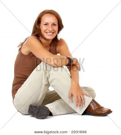 Casual Woman Smiling On The Floor