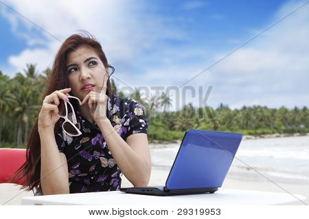 Thoughtful Businesswoman On The Beach