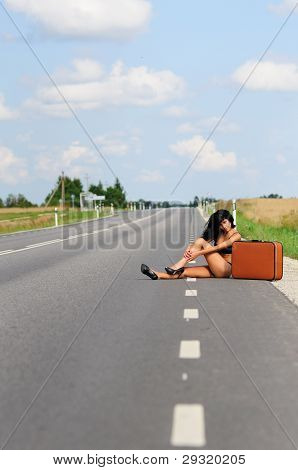 Woman In Bikini On Empty Highway