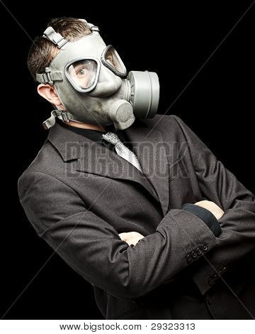 portrait of a business man with gas mask over black background