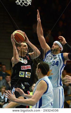 KAPOSVAR, HUNGARY - JANUARY 21: Michael Fey (white 34) in action at Hungarian National Championship basketball game with Kaposvar (white) vs. Szolnok (black) on January 21, 2012 in Kaposvar, Hungary.