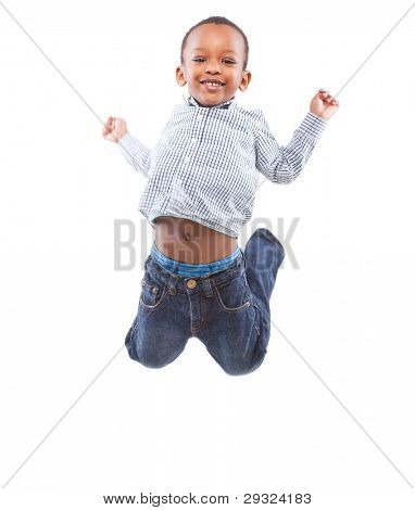 Young happy black boy isolated over a white background jumping in joy.