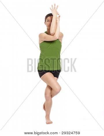 woman doing yoga, eagle position, with clipping path