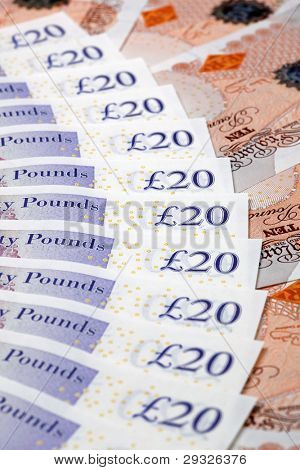 Twenty and ten pound notes laid out in a fan shape