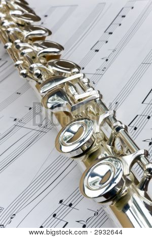 Flute Lay Across Sheet Music