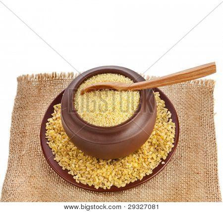 porridge kuskus couscous with bulgur  isolated on white