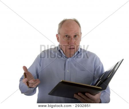 Man With Notebook Explaining Problem