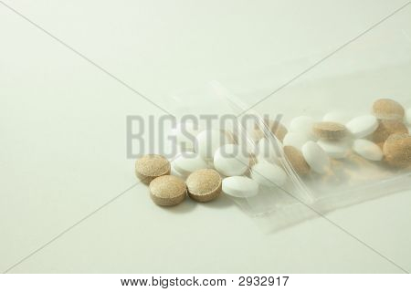 Brown And White Pills In Bag