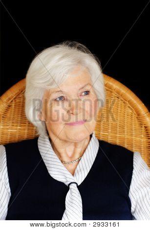 Senior Woman On A Chair