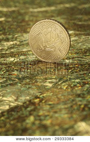 Euro currency coin on the golden background