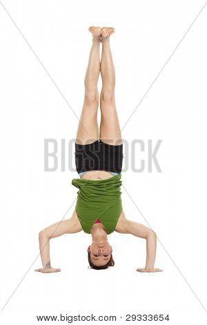 woman doing yoga, headstand, with clipping path