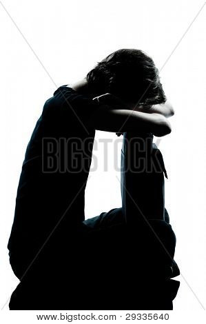 one caucasian young teenager silhouette girl crying sad full length in studio cut out isolated on white background