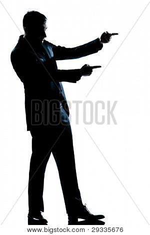 one caucasian man showing pointing empty copy space  full length silhouette in studio isolated white background