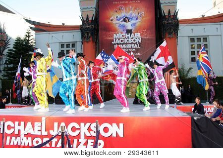 LOS ANGELES - JAN 26:  Cirque du Soleil Immortal Troupe perform at the Michael Jackson Immortalized  Handprint and Footprint Ceremony at Graumans Chinese Theater on January 26, 2012 in Los Angeles, CA