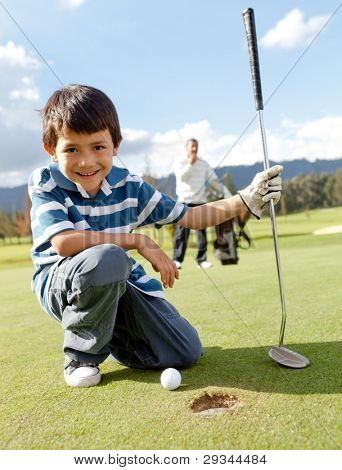 Young Boy playing Golf Club