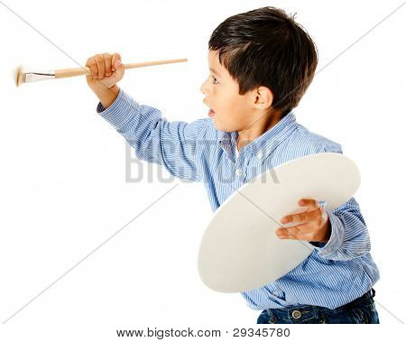Boy holding a brush and painting on the wall