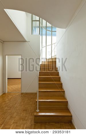 Bright duplex with hardwood floors,wooden stair