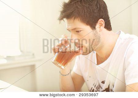 Man Sipping From A Glass