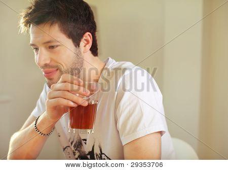 Young Man Enjoying Ice Tea