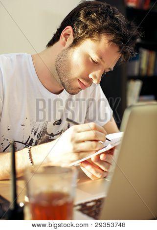 Hardworking Man Taking Notes