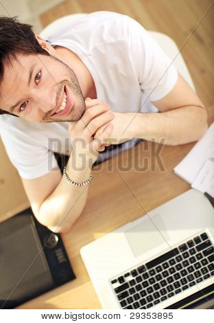 Overhead View Smiling Man At Laptop