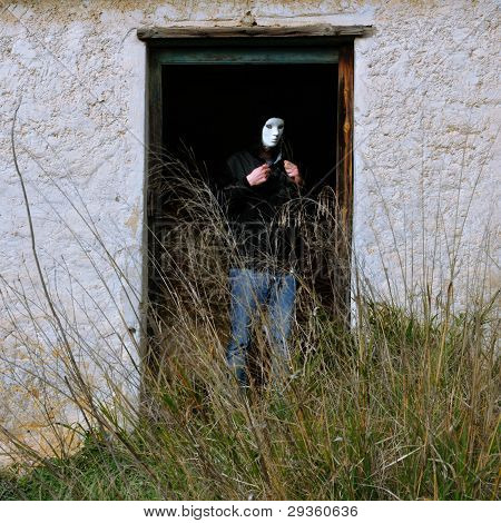 Masked Figure And Broken Door